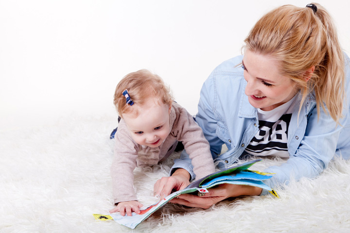 Reading to kids is SO important, but sometimes it's not as easy as snuggling up on the couch with your toddler to read a mountain of books. Here are some practical ideas to encourage wiggly toddlers to love books and develop essential literacy skills.