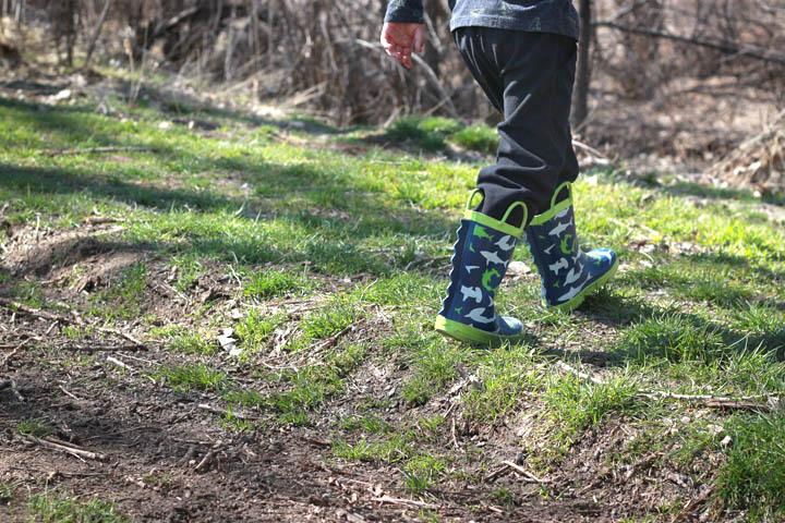 Child walking alone on grass