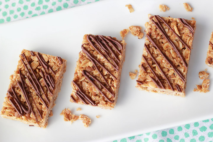 Need some new ideas for after school snacks? These homemade granola bars will get two thumbs up from the kids for taste, and they're full of healthy, protein-rich ingredients with just enough chocolate to sweeten the deal.