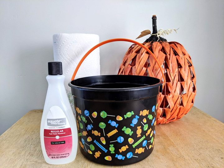 Supplies for making a DIY Batman Halloween trick-or-treat bucket