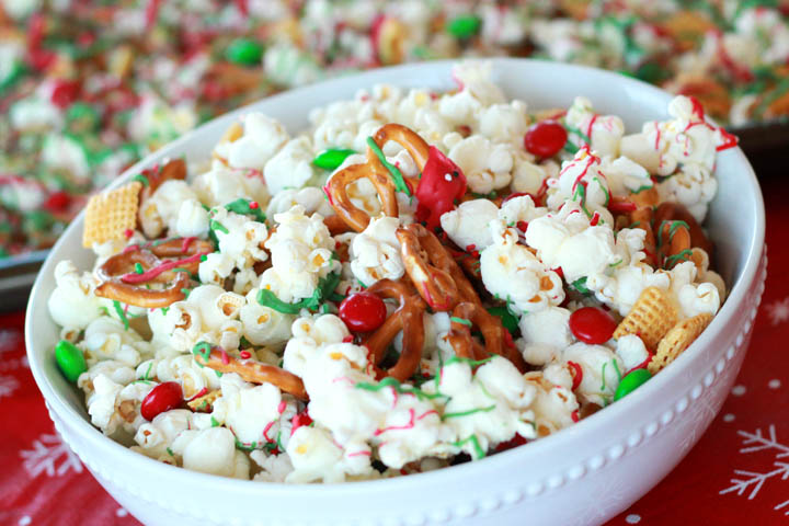 This easy-to-make Christmas popcorn snack mix is a perfect recipe for your holiday party, play-date, or Hallmark movie night!