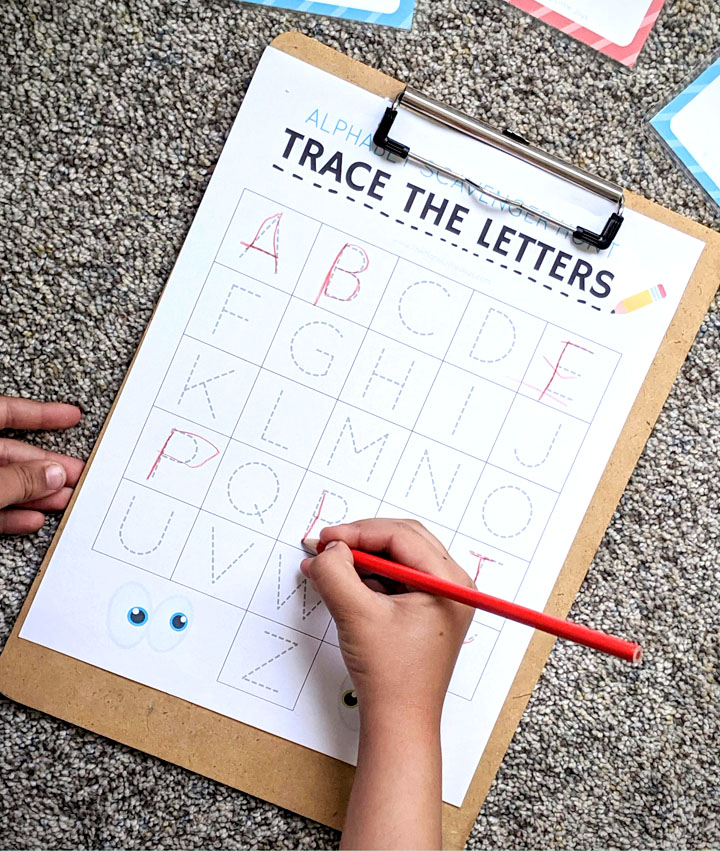"Turn boring handwriting practice into a fun game with this free printable ""trace the alphabet"" scavenger hunt activity."