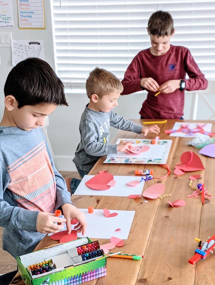 "Kids making ""heart monster"" Valentine's crafts."