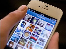 Person using Instagram on a mobile phone