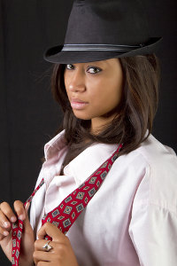 In a hat and tie © Daniel Raustadt | Dreamstime.com