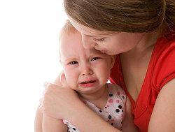 Mother comforting baby © Vasiliy Koval   Dreamstime.com