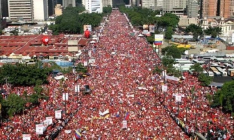 Mass population storming the government walls in Venezuala.