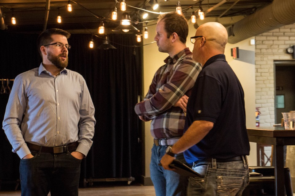 Purchasing director Justin Aiken (left) and Omaha territory manager Curt Knight (right) discuss our current products with a customer.