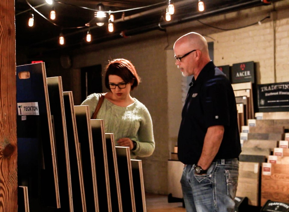 Omaha territory manager Curt Knight (right) shows a customer our unfinished engineered flooring products from Teckton.