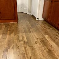 We put this in our kitchen. We absolutely love it. It works great with darker cabinets and it would also go with white if we ever changed our cupboards. We have 3 kids and a dog and have had no problems. We love our new floors.