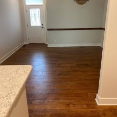 New Construction home - White Oak Barley throughout entire main level <br /> <small>Photographer: Sarah Dinsmore </small><small>Location: Bennington, Nebraska </small><small>Business: Dinsmore Flooring, Inc. </small><br />