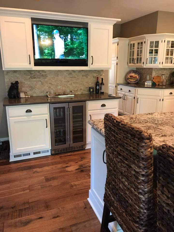 Reclaimed look prefinished solid wood floor from Real Wood Floors in kitchen and dining