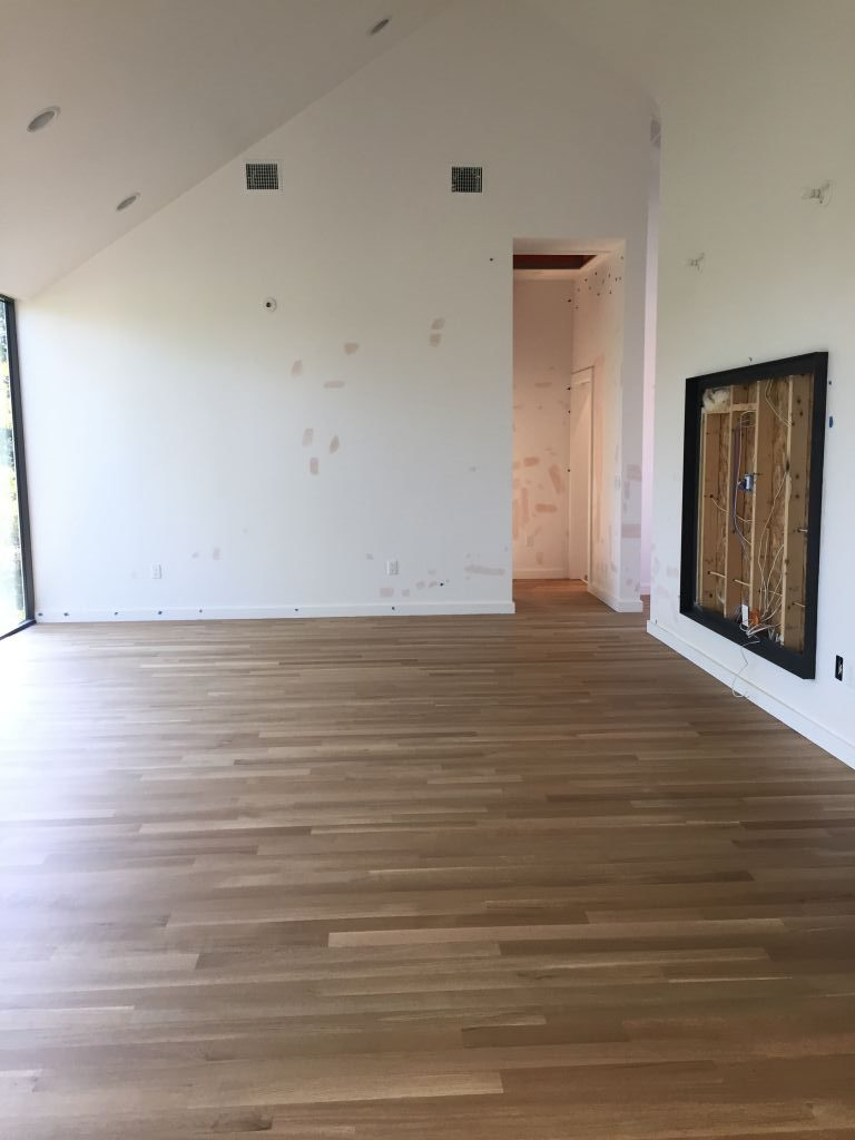 White oak sand and finish install in a new residential build
