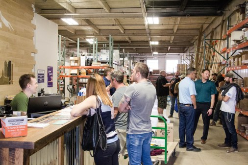 Employees and customers hang out during grand opening