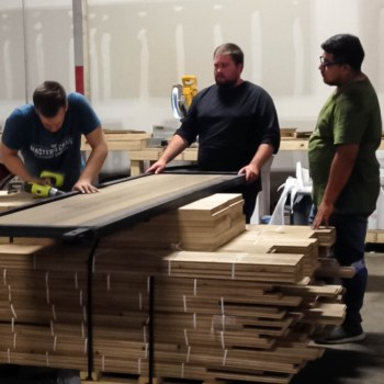 Employees build the prefinished barn doors.