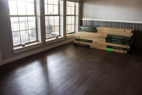 """Brick & Board """"Hearth"""" in living area"""