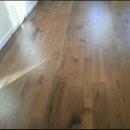 Saltbox Berkshire (Hickory) from Real Wood Floors was installed in the main living areas of the house: entry, living, dining, kitchen, halls.
