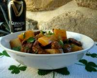 Irish Beef and GuinnessSteware tasty yet simple. It's not a great combination of spices or even ingredients. It is a portion of warm, delicious comfort food. One that caresses your skin on that cold winter night and brings warmth to your belly.