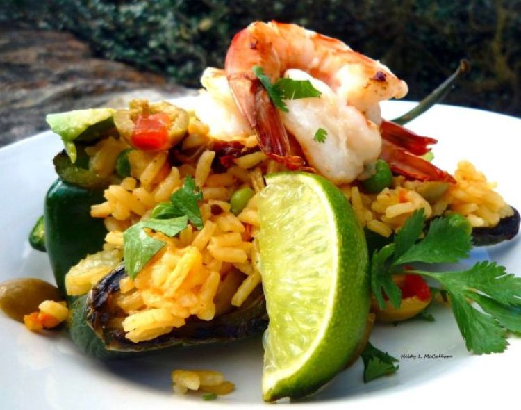Stuffed Poblano Peppers NEVER tasted so easy and good! These AMAZING Peppers are stuffed full of a glorious concoction of Saffron Rice with a variety of vegetables to make this a wonderfully flavorful and enticing meal! The BONUS is the tasty Grilled Lime Shrimp!