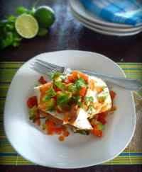 Chicken and Refried Bean Burritos made with a delicious homemade Refried Beans mixture, juicy seasoned white tender chicken breast meat, long grain white rice, Colby Jack cheese, Hass avocados, fresh Homemade Salsa with Poblano Chilies and chopped fresh cilantro.