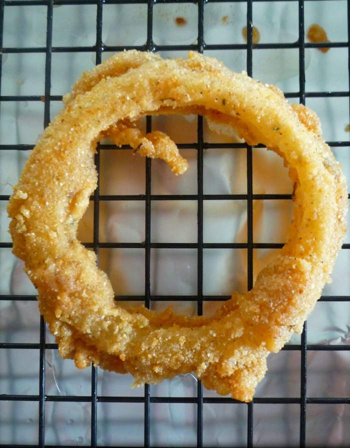 This delicious recipe for Cajun-Style Crispy Onion Rings are proudly featured on slapyamama.com they're so damn good