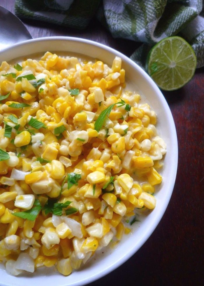 Mexican-Style Creamed Corn is the perfect simple to make,  almost foolproof side dish for almost any meal you enjoy corn with, combining a deliciously sweet, freshly picked, organic corn on the cob, rich heavy cream,  a drizzle of organic honey, sweet unsalted butter, a touch of minced jalapeño peppers, chopped organic cilantro and a hint of freshly squeezed lime juice