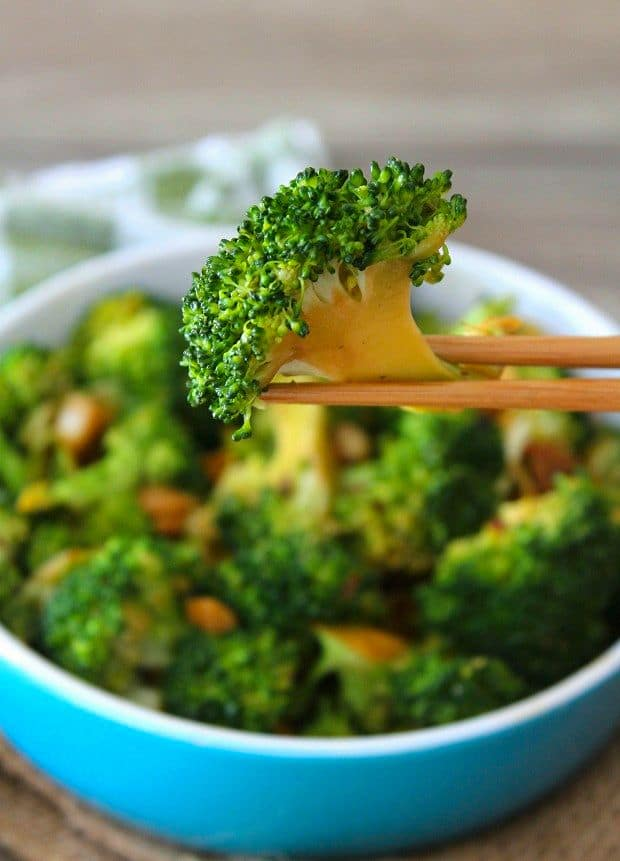Spicy Asian-Style Broccoli is a deliciously simple dish made from broccoli spears tossed with soy sauce thinly sliced fresh garlic, soy sauce, chili pepper flakes, sweet rice vinegar, sesame oil, and a hint of brown sugar.  Hands down this Spicy Asian-Style Broccoli will beat every takeout container of Chinese you can get without exception.