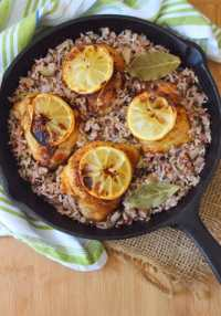 Lemon Chicken with Wild Rice is a deliciously flavorful easy to make meal cooked in one skillet combining wine-infused wild rice with perfectly cooked tender and juicy chicken thighs for a simple yet elegant tasting dinner.