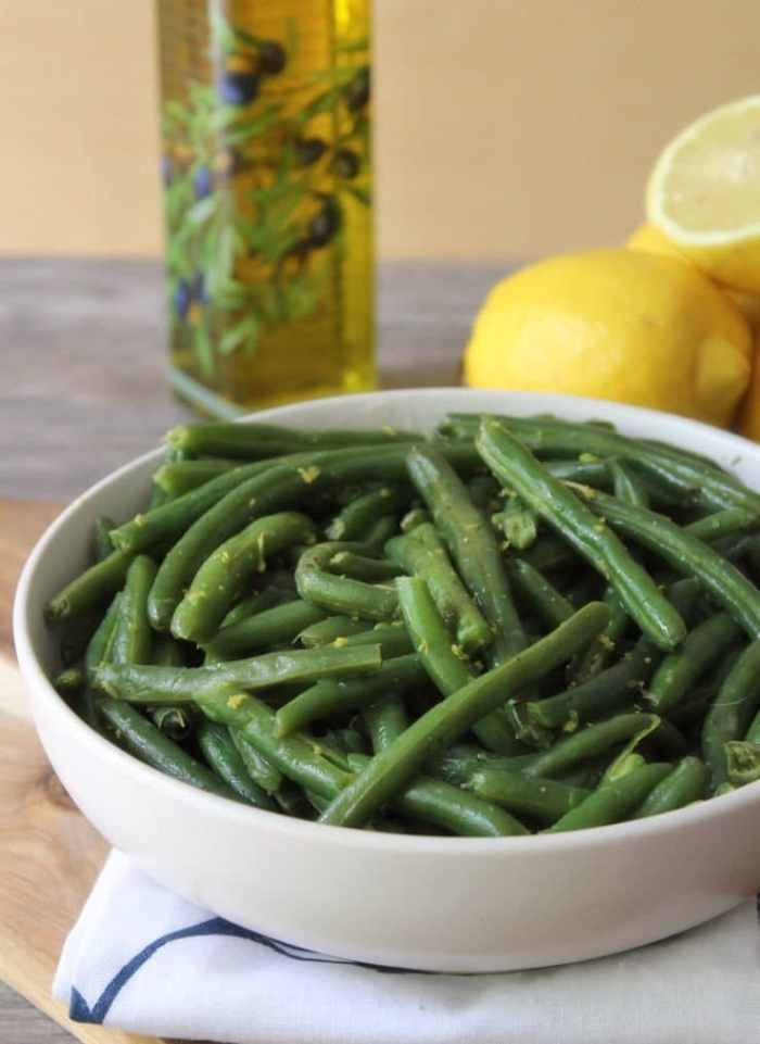 These deliciously lemony flavored green beans are quick and easy to make using an Instant Pot or pressure cooker. Lemony Green Beans are the perfect side for almost any meal and take only about 10 minutes to make using a pressure cooker or Instant Pot.