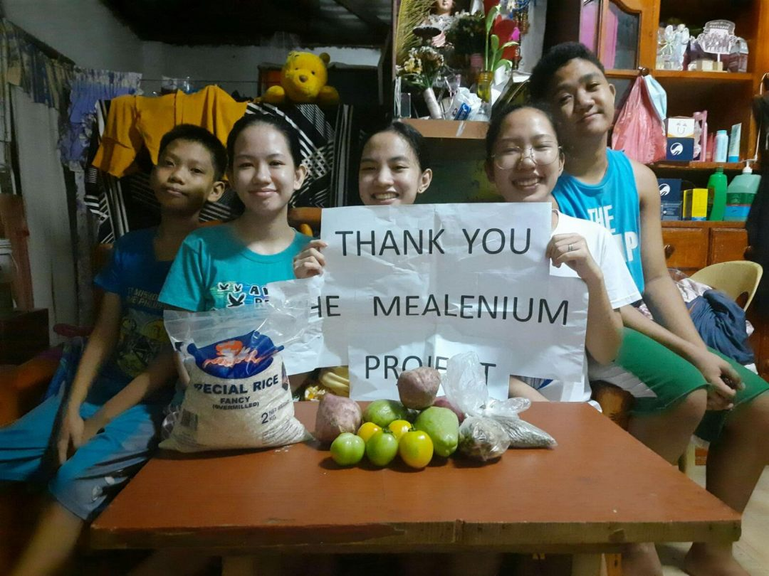 Beneficiaries of the community pantry organized by Erika Chua of The MEALenium Project