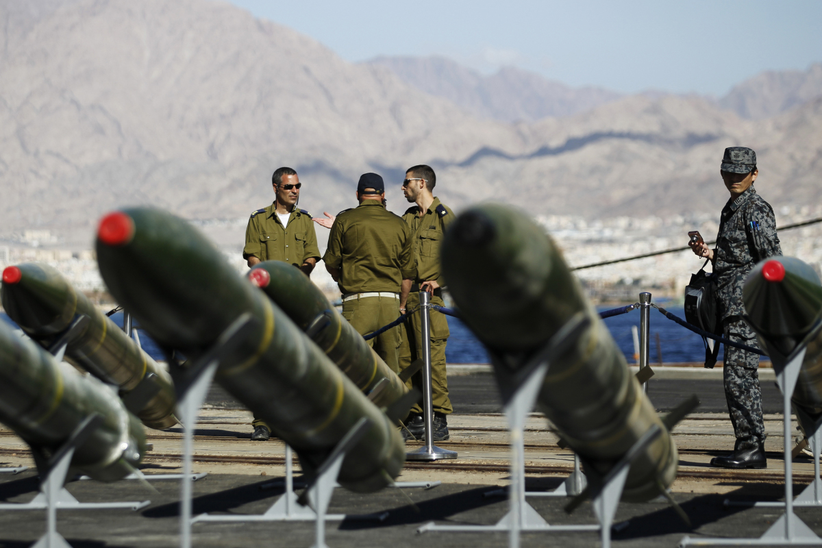 Israeli soldiers stand near a display of M302 rockets found aboard the Klos C ship at a navy base in Eilat