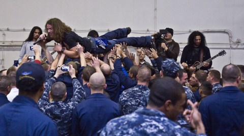 Beaux Foy surfing the crowd at an Airiel Down concert for the military