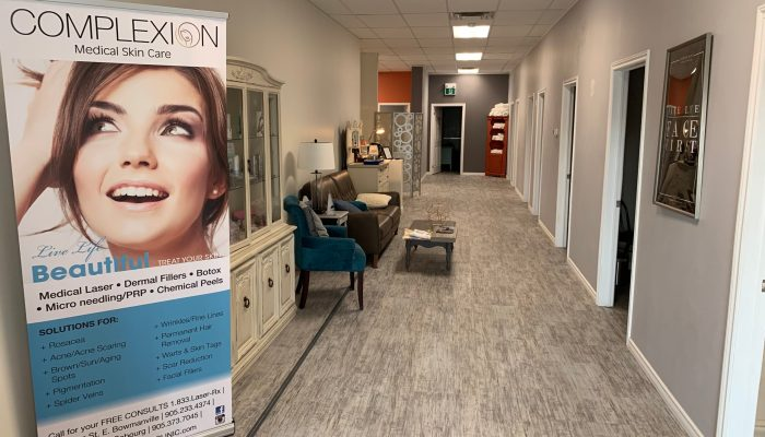 hallway with sign and couches of Port Hope Complexion Medical Spa