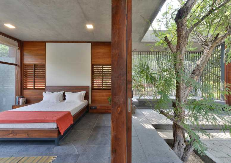 9--view-of-the-guest-bedroom-alongwith-courtyard-and-existing-amla-tree