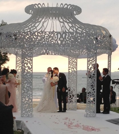 Outdoor pergola by the beach for Mario Lopez and Courtney Mazza's wedding