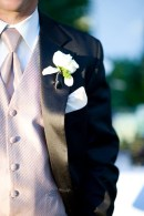 Groom with a mauve tie and vest