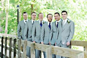 Groom with silver tie and groomsmen with cobalt blue ties and grey suits