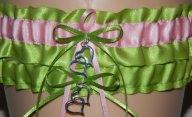 Wedding garter in apple green and light pink, by WeddingGarterStore on etsy.com