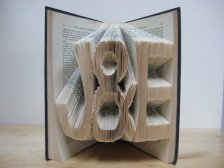 Customised book art centrepiece, by TheBookVandal on etsy.com