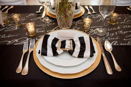 Black, gold and white table setting idea {via weddingobsession.com}