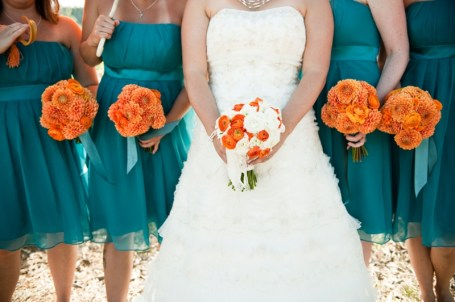 Bridesmaids in teal with orange bouquets {via theeverylastdetail.com}