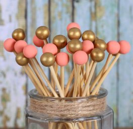 Coral and gold rock candy sticks - www.etsy.com/shop/thebakersconfections