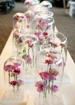 Great centrepiece idea - flowers under glass domes {via blog.accentdecor.com}