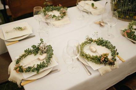 Wreaths as place-settings {via greenweddingshoes.com}