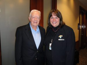 President Jimmy Carter with Nancy Harvey of the Delta Sky Club (DTW)