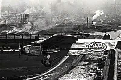 A plane flies over Detroit circa 1930s