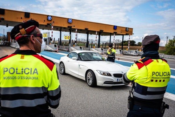 Catalan police control checkpoint. People without authorisation are fined.
