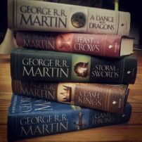 Catching up on the series in hopes that it will be fresh in my head when George finally comes out with the next book.