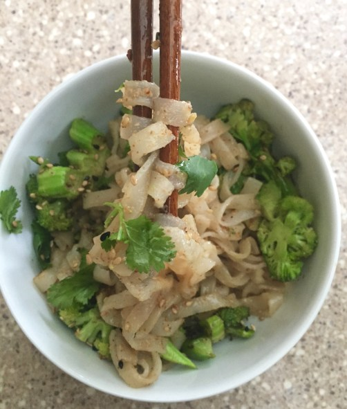 Bowl of almond butter vegetable stir-fry with pad thai rice noodles
