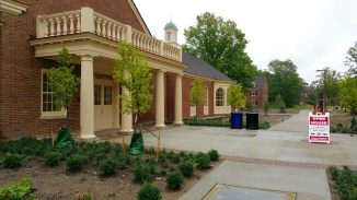 The front entrance to the Garden Commons is on the south side of the building that faces the back of the Farmer School of Business.